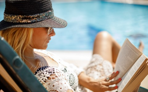 a woman relaxing by the pool