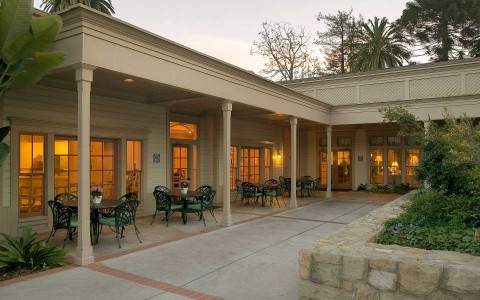 the patio area at the hotel at dusk