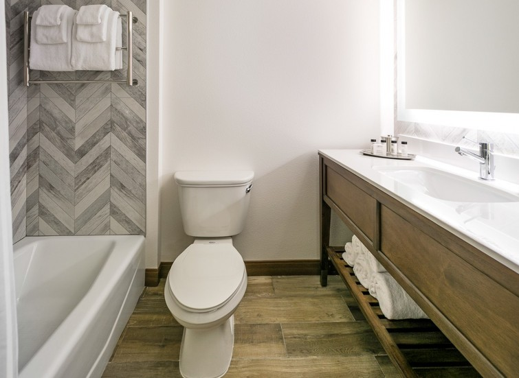 a guest bathroom with modern decor