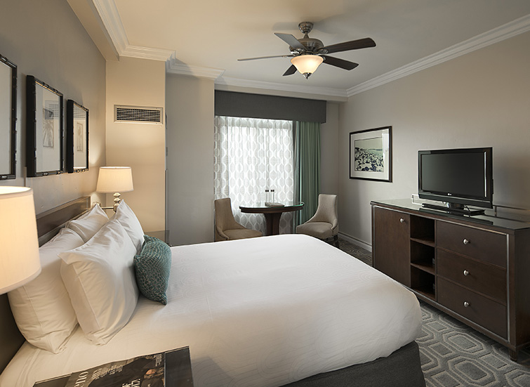 king room with accent pillow and fan