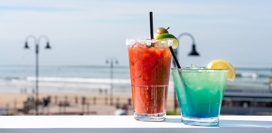 2 cocktails with view of beach
