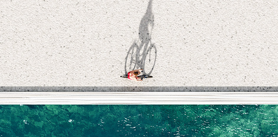 overhead of person biking