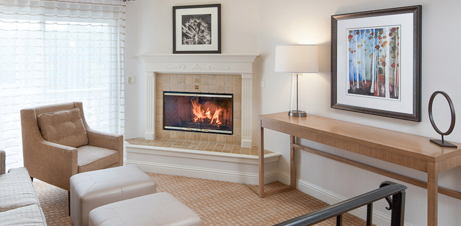a guest room with a fireplace
