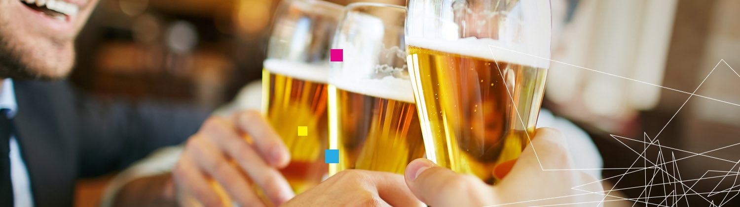 Close up of glasses of beer toasting