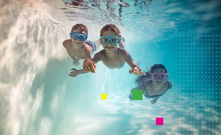 three kids swimming underwater in a pool
