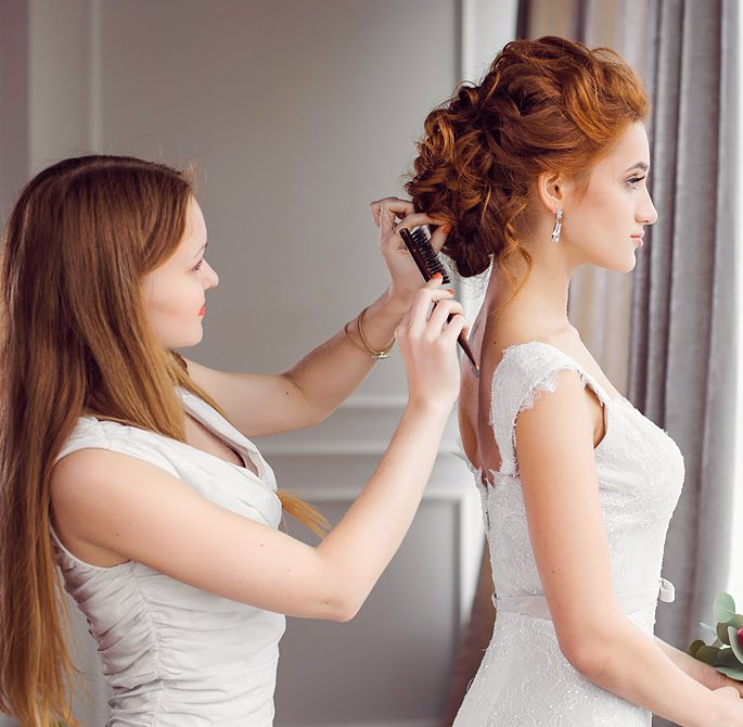 Woman getting her hair done before her wedding
