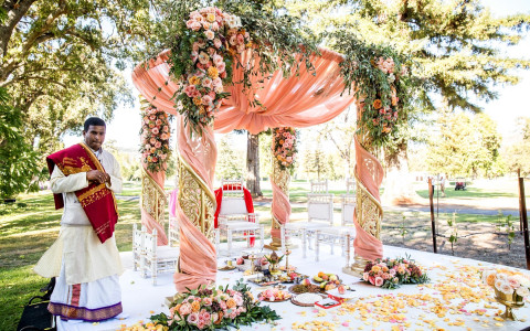 Indian Wedding setup of the ceremony featuring blush accents