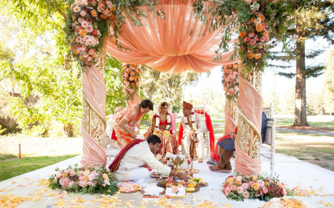 Indian Wedding Ceremony with a colorful arch and beautiful flowers for decor