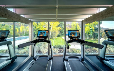 two treadmills facing windows
