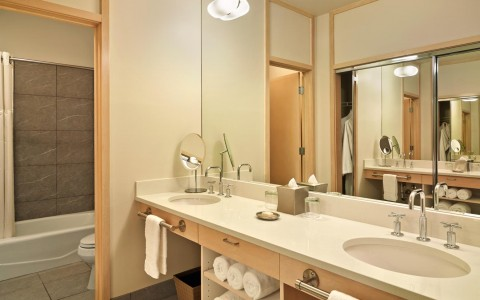 two sinks with bathroom accessories