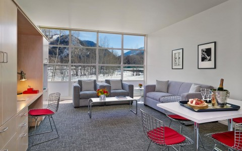living room with couches, dining table, and window view of snow