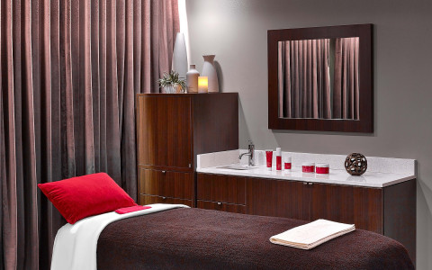 Spa room with red pillow