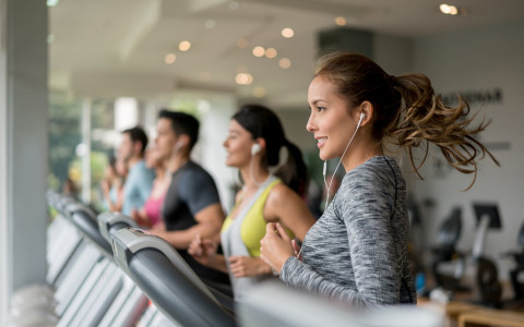 Men and women running on treadmills