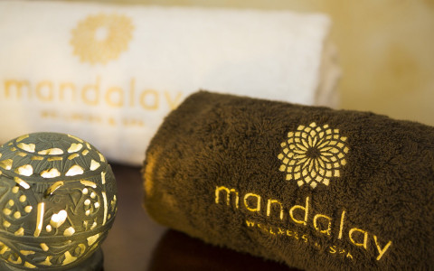 Brown towel with Mandalay logo and green light