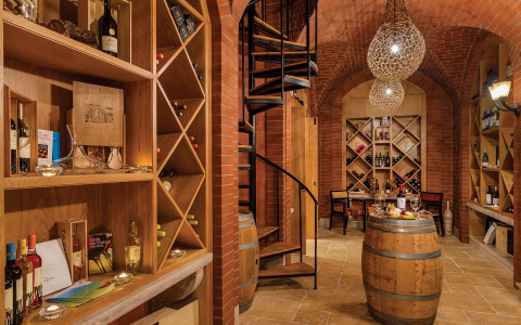 Wine cellar with wooden walls and spiral iron staircase
