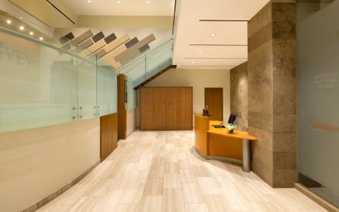 lobby area with wooden floors and the front desk
