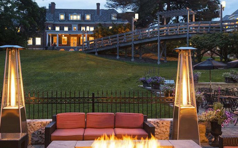 Ivey Spencer and an elevated walkway can be seen in the distance from the fire pit patio