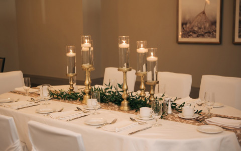 gold candle sticks on a formal dinner table