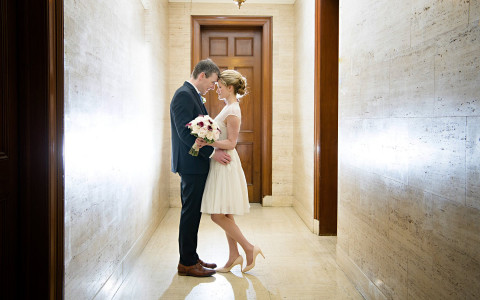 man and woman kissing in a hallway of hotel