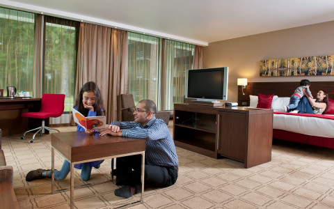 family playing together in hotel suite