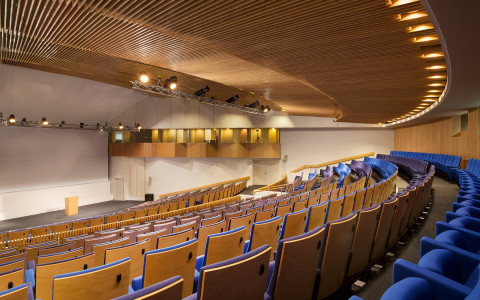 auditorium with blue chairs