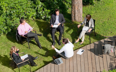 overhead shot of people having a meeting outside