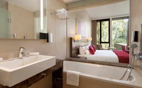 bathroom in suite with bed in background