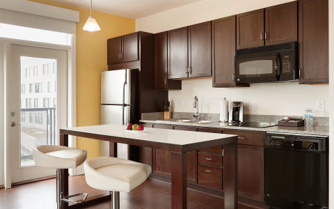 brown kitchen cabinets with granite countertop