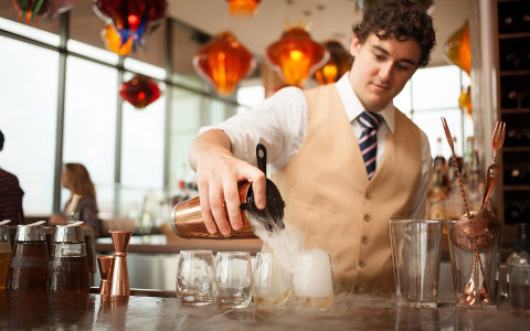 man pouring cocktail in restaurant