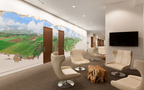 Hotel lobby with Indiana mural on wall