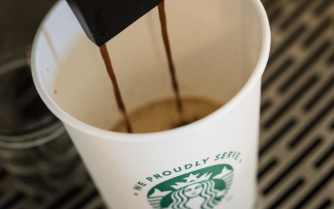 a closeup picture of our coffee machine pouring starbucks coffee which is offered in our market