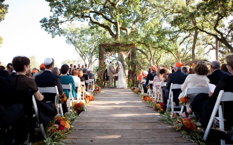 Beautifully decorated wedding ceremony located outside on The Grove