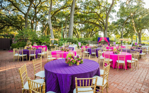 Elegant purple and pink themed table setting and decor for an Indian wedding