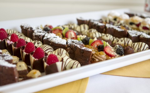 Decadent desserts served on a platter for a business meeting