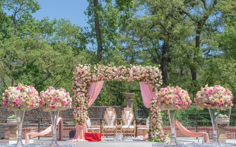 MP Singh Photography LLC, exquisite Indian wedding ceremony setup featuring big beautiful bouquets of pink and white toned roses