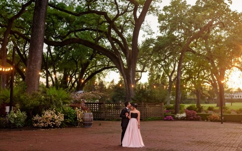 MP Singh Photography LLC, Bride and groom embracing with a gorgeous backdrop of the grove during sunset