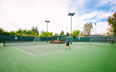 Players during a game of tennis out on the courts