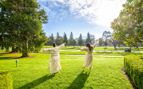 Resort guests out on the lawn with breathtaking views of the grounds