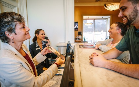 Silverado front desk team members greeting new guests