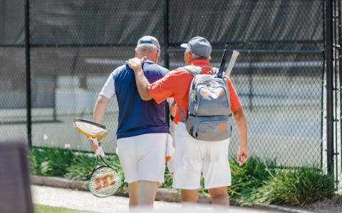 Two buddies getting ready to play out on the tennis courts
