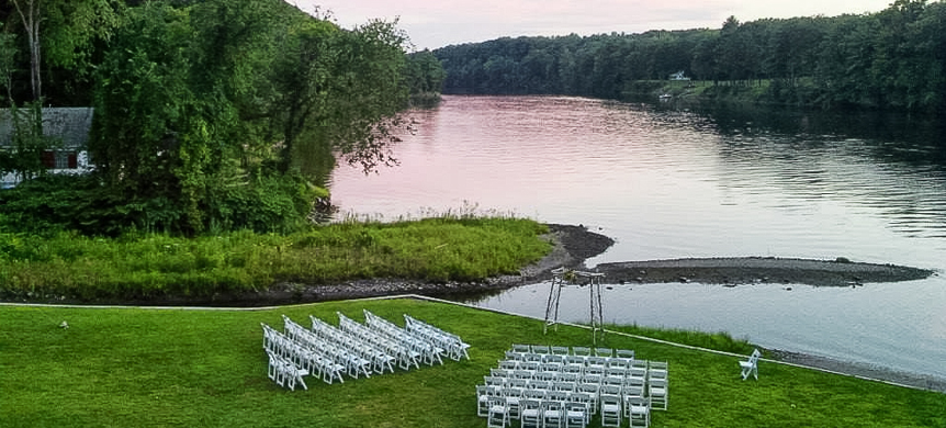 chairs set by a lake for a wedding