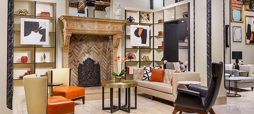 Modern lobby area with orange pop color and fireplace