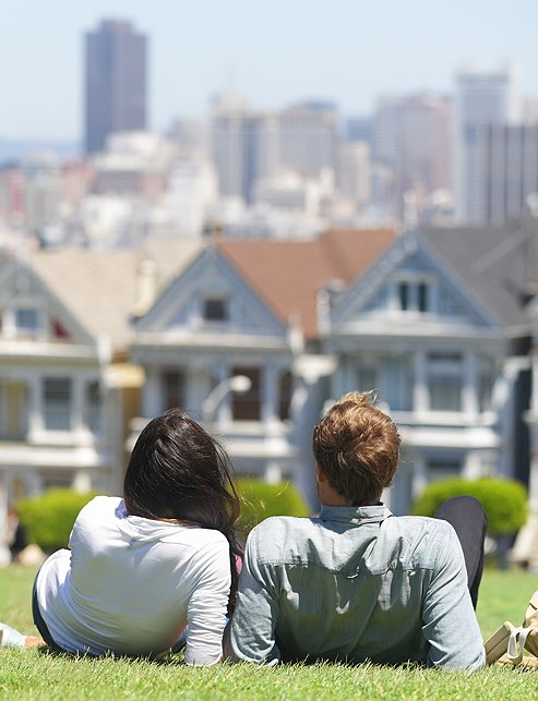 Couple on hill enjoying San Francisco view
