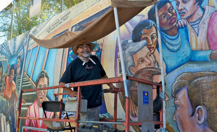 Man painting Great Wall of L.A. Restoration