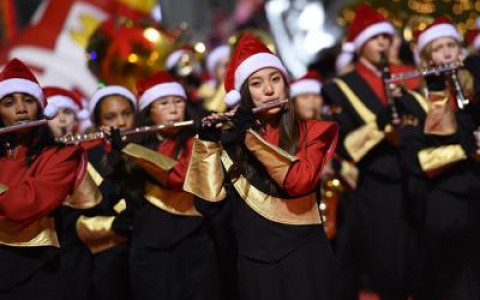 Marching Band Flute Players with Santa Caps in Christmas Parade