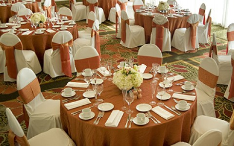Airtel wedding reception circular tables draped in pink and white linen and fine table ware