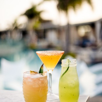 colorful fruit cocktails by the pool