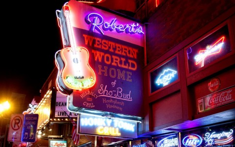 Roberts Western World neon sign lit up at night