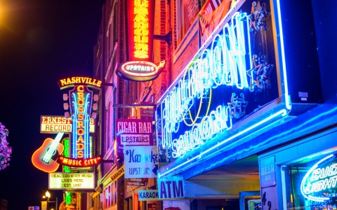 Nashville Honkey Tonk Bars lit up at night with neon lights