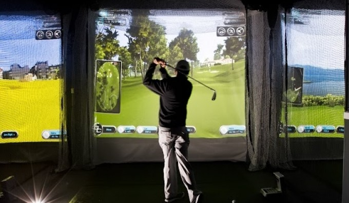 man teeing off at virtual golf